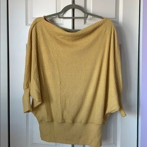 Yellow cowl/off shoulder top.